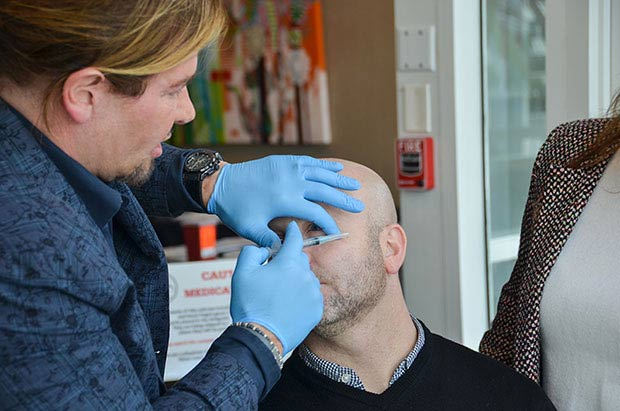 Stephen Cosentino, DO demonstrating proper technique for Botox injection