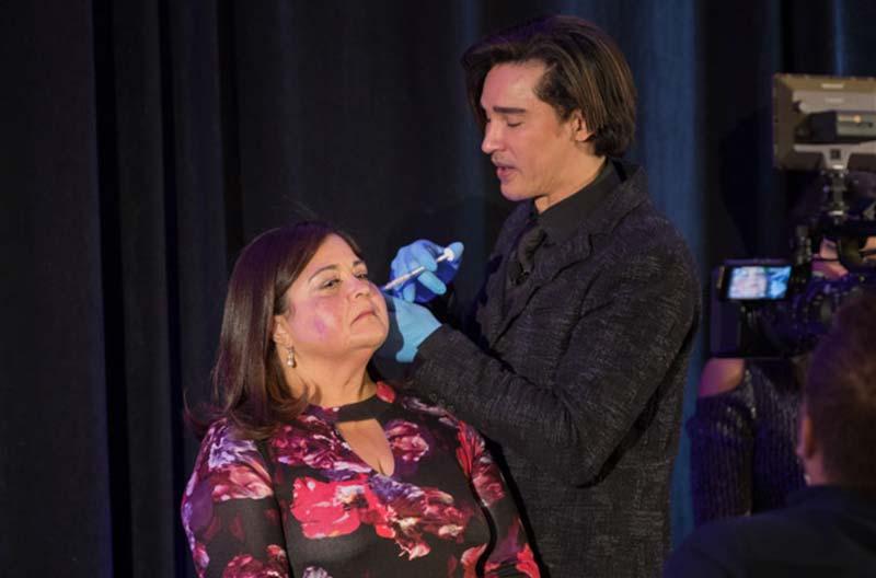 Dr. Shino Bay Aguilera injecting woman face