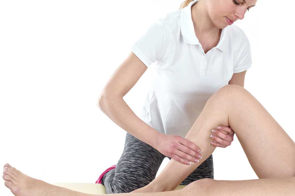 Physical Therapist performing knee mobility testing