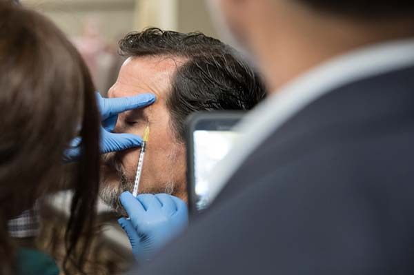 Attendee performing Crows Feet injection