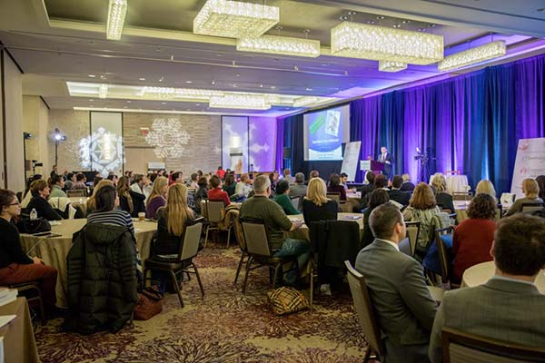 Empire Aesthetic Event ballroom with attendees
