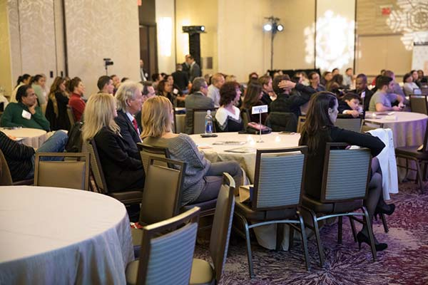 Attendees engaged in Aesthetic Talks