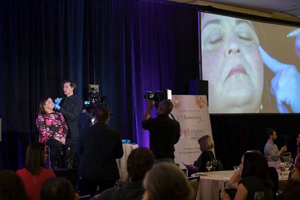 Dr. Aguilera performing upper cheek bone injection using fillers